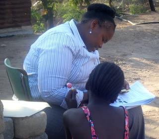 A young girl being interviewed by an woman in South Africa